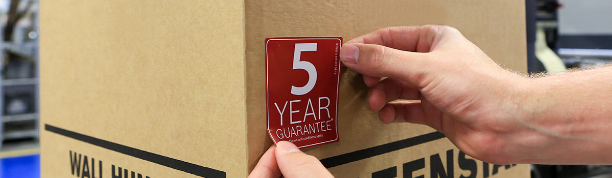 warranty label being stuck on box